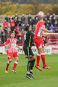 Accrington Stanley defender Tom Davies  beats York City forward Vadaine Oliver to the header during the The FA Cup match between Accrington Stanley and York City at the Fraser Eagle Stadium, Accrington, England on 7 November 2015. Photo by Simon Davies.