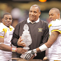 2008 November, 29: Grambling State head coach Rod Broadway holds the Bayou Classic championship trophy with players Greg Dillon (1) and Keefe Hall (44) following a 29-14 victory by Grambling State University over Southern University during the 35th annual State Farm Bayou Classic at the Louisiana Superdome in New Orleans, LA.  .