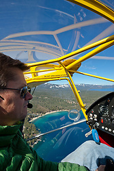 """""""Pilot Over Lake Tahoe 4"""" - This pilot was photographed flying an amphibious seaplane over Lake Tahoe, CA."""