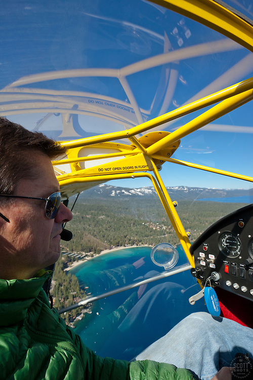 """Pilot Over Lake Tahoe 4"" - This pilot was photographed flying an amphibious seaplane over Lake Tahoe, CA."