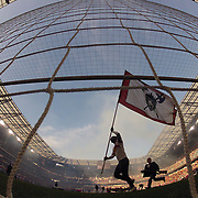 A flag bearer runs past the goalmouth during pre game presentations before the New York Red Bulls Vs New England Revolution, MLS Eastern Conference Final, first leg at Red Bull Arena, Harrison, New Jersey. USA. 23rd November 2014. Photo Tim Clayton