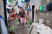 Mayuri Mahesh Pandit, 13, (centre) is walking towards the Unicef-run 'Deepshikha Prerika' project inside the Milind Nagar Pipeline Area, an urban slum on the outskirts of Mumbai, Maharashtra, India, where she resides with her family.