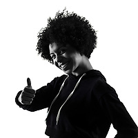 one mixed race african young teenager girl woman Thumbs Up in studio shadow silhouette isolated on white background