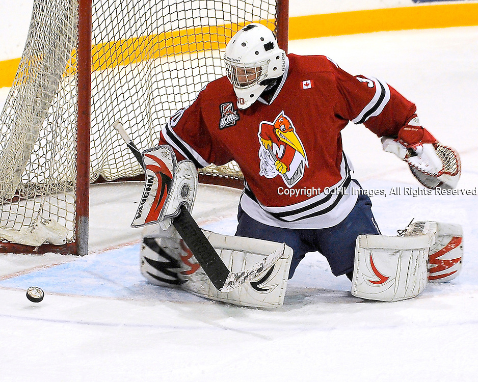 NEWMARKET, ON - Nov 14 : Ontario Junior Hockey League Game Action between the Newmarket Hurricanes Hockey Club and the Stouffville Spirit Hockey Club.  Jophrey Gregoire #30  of the Newmarket Hurricanes Hockey Club makes the save.<br /> (Photo by Phillip Sutherland / OJHL Images)