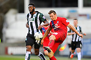 York City's Dave Winfield clears the ball under pressure from Plymouth Argyle's Jamille Matt during the Sky Bet League 2 match between Plymouth Argyle and York City at Home Park, Plymouth, England on 28 March 2016. Photo by Graham Hunt.