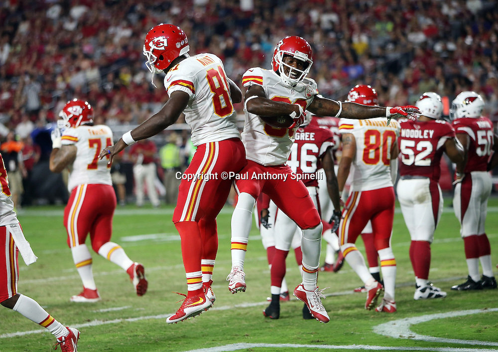 Kansas City Chiefs wide receiver Jason Avant (81) leaps and celebrates with Kansas City Chiefs wide receiver Fred Williams (83) after Williams catches a 13 yard second quarter touchdown pass that ties the score at 10-10 during the 2015 NFL preseason football game against the Arizona Cardinals on Saturday, Aug. 15, 2015 in Glendale, Ariz. The Chiefs won the game 34-19. (©Paul Anthony Spinelli)