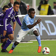 Steven Mendoza, NYCFC, dribbles past Darwin Ceren, (left), Orlando, during the New York City FC Vs Orlando City, MSL regular season football match at Yankee Stadium, The Bronx, New York,  USA. 18th March 2016. Photo Tim Clayton