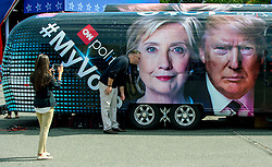 Sept.26, 2016 - Hempstead, New York, U.S. -  People pose in front of the CNN My Vote camper parked at Hofstra University, site of the first of three scheduled debates between presidential candidates Hillary Clinton and Donald Trump.(Credit Image: © Brian Cahn via ZUMA Wire)