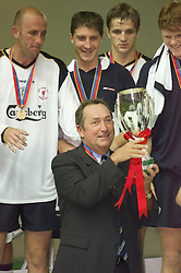 MONACO, FRANCE - Friday, August 24, 2001: Liverpool's manager Gerard Houllier lifts the UEFA Super Cup after his side beat Bayern Munich 3-2 during the UEFA Super Cup Final at the Stade Louis II. Also pictured Gary McAllister, Gregory Vignal and Igor Biscan. (Pic by David Rawcliffe/Propaganda)