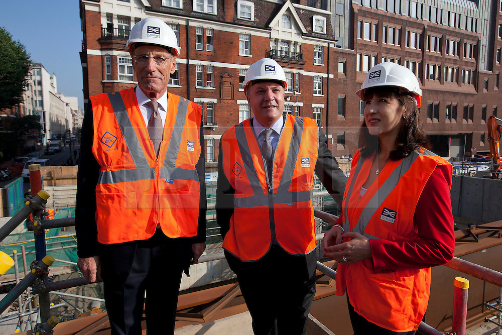 © Licensed to London News Pictures. 05/09/2013. London, UK. Shadow Chancellor Ed Balls (C), Shadow Chief Secretary to the Treasury Rachel Reeves (L) and Sir John Armitt chief of a review of long-term infrastructure planning in the UK (R) are seen at the site of the Bond Street Crossrail station in London today (05/09/2013). The station forms part of the Crossrail train line, which will be 73 miles (118 km) long when finished in 2018, will connect Maidenhead and Heathrow in the west of London to Shenfield and Abbey Wood in the east, passing under central London to create a new commuter link. Photo credit: Matt Cetti-Roberts/LNP