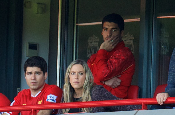LIVERPOOL, ENGLAND - Saturday, September 21, 2013: Liverpool's banned Luis Suarez watches the game between Liverpool and Southampton during the Premiership match at Anfield. (Pic by David Rawcliffe/Propaganda)
