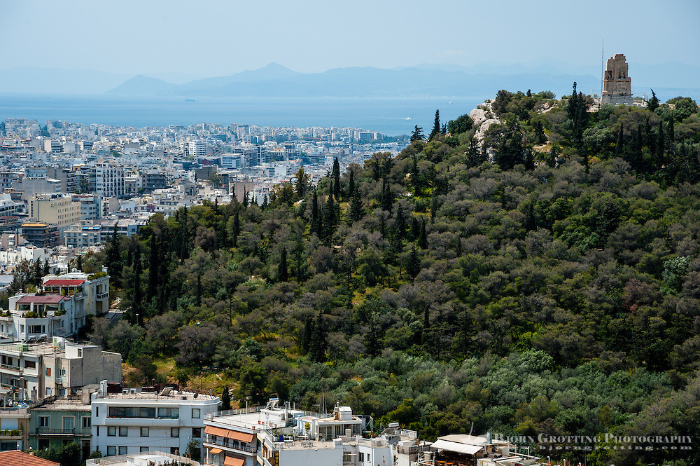 Greece, Athens. View of Athens from the famous Acropolis.  The Philopappos Monument.