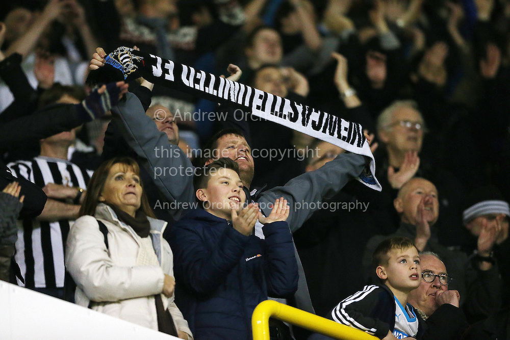 Newcastle united fans celebrate after Ayoze Perez of Newcastle United scored his sides 2nd goal to make it 2-1. Barclays Premier league match, Tottenham Hotspur v Newcastle Utd at White Hart Lane in London on Sunday 13th December 2015.<br /> pic by John Patrick Fletcher, Andrew Orchard sports photography.