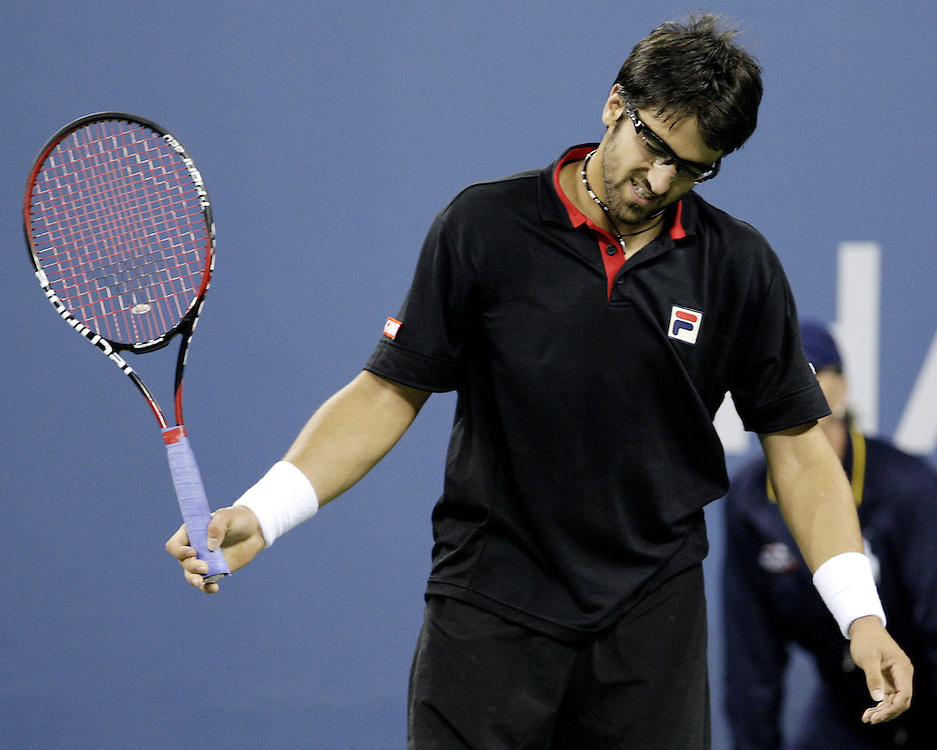Janko Tipsarevic of Serbia reacts to losing a point against Rafael Nadal of Spain during their second round match on the fifth day of the 2007 US Open tennis tournament in Flushing Meadows, New York, USA, 31 August 2007.