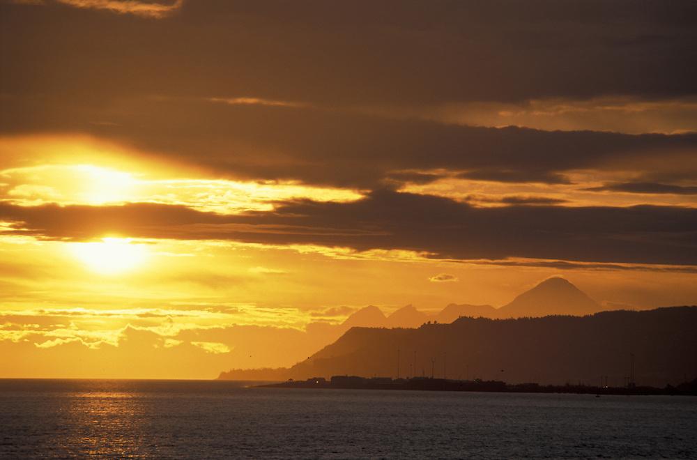 Sunset pver Homer seen from.Kachemak Bay Wilderness Lodge.over Aleutian Range.Alaska.USA