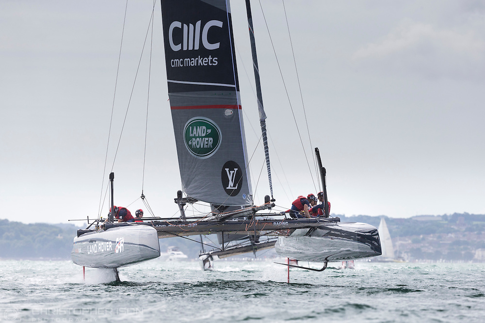 Sir Ben Ainslie at the helm of his AC45 foiling catamaran Land Rover BAR in Portsmouth at the start of the America's Cup World Series which runs until Sunday. <br /> The world's oldest sporting trophy has not been contested in British waters until now.<br /> Ainslie's team hope to wrestle it back from the current holders Oracle Team USA.<br /> Picture date: Thursday July 23, 2015.<br /> Photograph by Christopher Ison &copy;<br /> 07544044177<br /> chris@christopherison.com<br /> www.christopherison.com