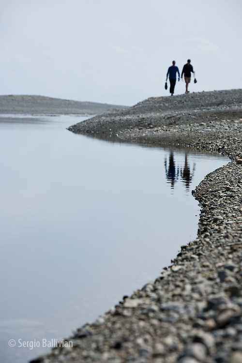 West Coast Trail - Day 3. Two hikers walk along the Klanawa River.