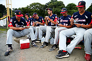 Members of the Bounre Braves play the card game President during game one of the Cape Cod League Championship Series against the Brewster Whitecaps at Stony Brook Field on August 11, 2017 in Brewster, Massachusetts.