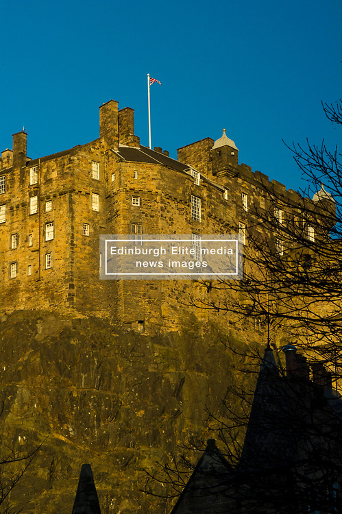 Pictured: Edinburgh Castle from the Grassmarket<br /> <br /> A view less often seen of Edinburgh Castle; which has never been over taken; with the Uniion flag blowing in the winter sun<br /> <br /> Ger Harley   EEm 28 January 2019