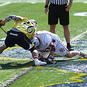 Drexel Midfielder Nick Saputo (16), LEFT, faces-off with Denver Midfielders Chris Hampton (20), RIGHT, during the second half of The NCAA Division I Men's Lacrosse Tournament game between No. 12 ranked Drexel and No. 5 seed Denver Sunday, May. 18, 2014 at Delaware Stadium in Newark, DEL