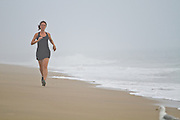 Natalie Rockwell runs on the beach in Bethany Beach, Delaware.