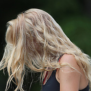 Caroline Wozniacki, Denmark, fixes a microphone to herself during a media session before the 1st round of the Connecticut Open at the Connecticut Tennis Center at Yale, New Haven, Connecticut, USA. 17th August 2014. Photo Tim Clayton