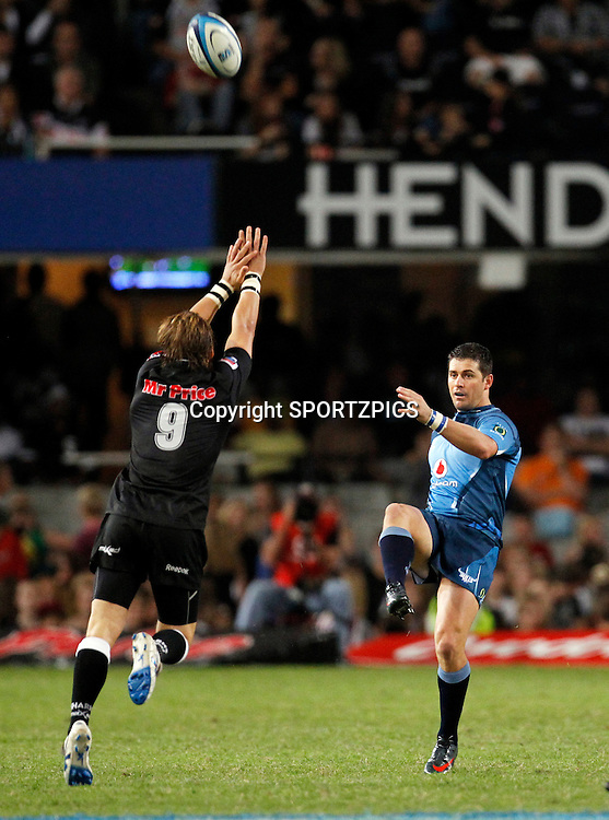 Morne Steyn kicks past Charl McLeod during the Super 15 match between the Sharks and the Bulls played in Durban on the 21 May 2011..Photo by: SPORTZPICS