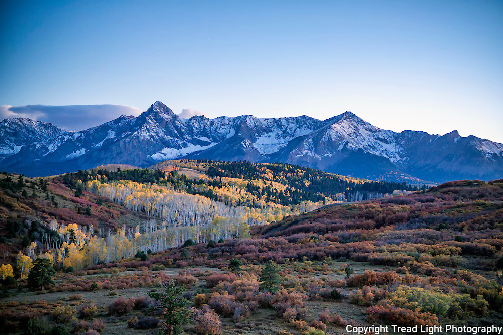 Aspens and scrub oak turn their fall colors near Last Dollar Road into Telluride.
