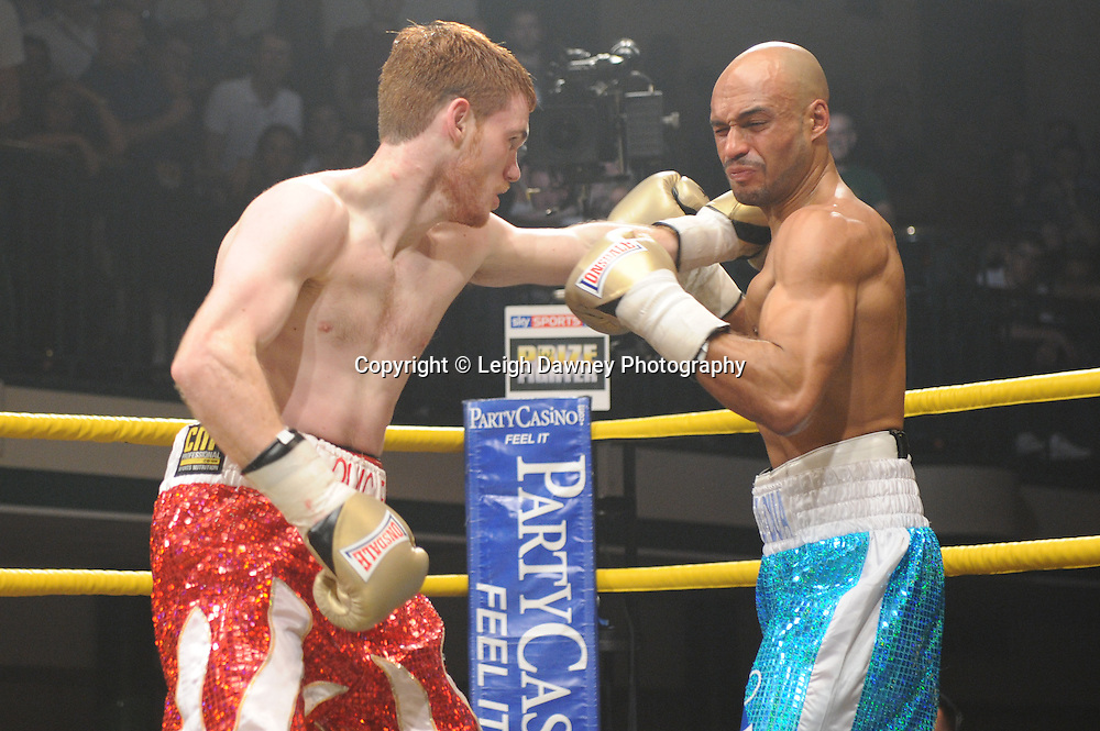 Nick Quigley defeats Kris Agyei-Dua (tourquoise shorts) in Semi Final Two of Prizefighter  - The Light Middleweights II. York Hall, Bethnal Green, London, UK. 15th September 2011. Photo credit: © Leigh Dawney.