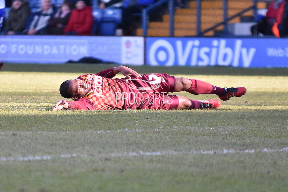 Bradford City Midfielder, Kyel Reid is challanged during the Sky Bet League 1 match between Bury and Bradford City at the JD Stadium, Bury, England on 5 March 2016. Photo by Mark Pollitt.