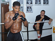 Picture by Alan Stanford/Focus Images Ltd +44 7915 056117<br /> 30/09/2013<br /> Anthony Joshua MBE performs in a media workout watched by trainer Tony Sims at Gator ABC, Hainault, Essex..