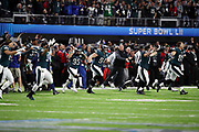 Philadelphia Eagles players run onto the field in celebration after the team wins the 2018 NFL Super Bowl LII football game against the New England Patriots on Sunday, Feb. 4, 2018 in Minneapolis. The Eagles won the game 41-33. (©Paul Anthony Spinelli)
