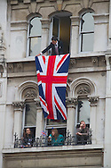 Onlookers in a building overlooking in Whitehall, London, awaiting the newly-wed Prince William and Catherine Middleton to drive from the marriage ceremony towards Buckingham palace. The wedding was held at Westminster Abbey. Tens of thousands of people lined the streets to wish the couple well before and after the ceremony.