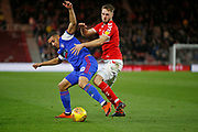 Middlesbrough midfielder Lewis Wing (26) and Ipswich Town defender Myles Kenlock (30) contest a loose ball  during the EFL Sky Bet Championship match between Middlesbrough and Ipswich Town at the Riverside Stadium, Middlesbrough, England on 29 December 2018.