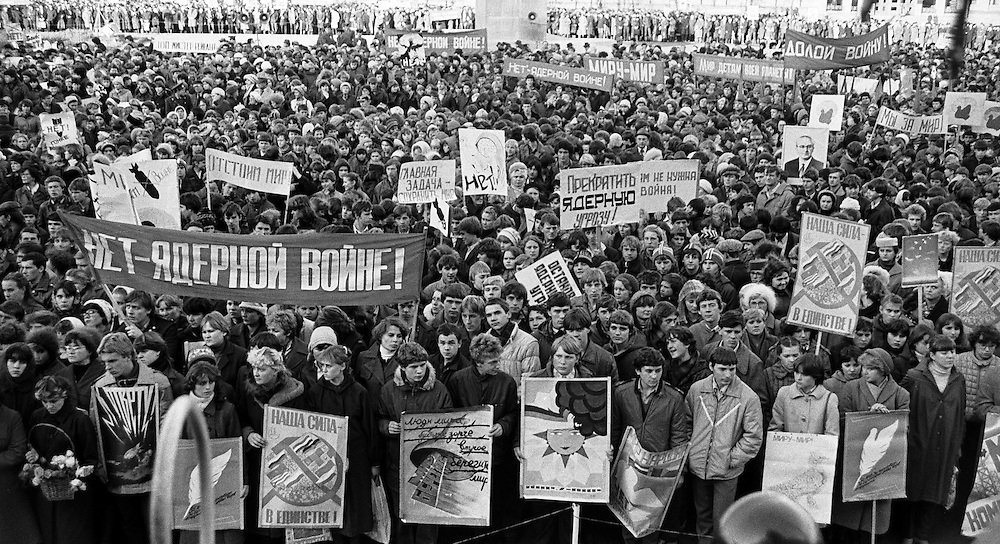 Soviet people protest against Nuclear war and nuclear threat during rally in downtown of  Kemerovo, Eastern Siberia, 28  May 1981. B&W negative film 35mm. On the banner reads 'No - nuclear war'.