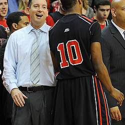 Rutgers Scarlet Knights head coach Mike Rice celebrates Rutgers' 67-60 upset victory over #8 UConn in NCAA Big East Basketball action at the Louis Brown Athletic Center in Piscataway, N.J. on Jan 7, 2012.