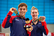 Tom Daley of Great Britain and Grace Reid of Great Britain with their Gold Medals in the Mixed Syncronised 3m dive at the FINA/CNSG Diving World Series 2019 at London Aquatics Centre, London, United Kingdom on 19 May 2019.