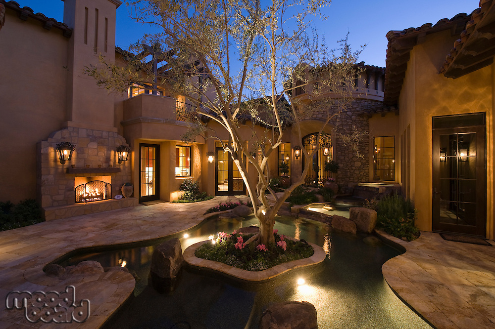 Lit Palm Springs courtyard with pool