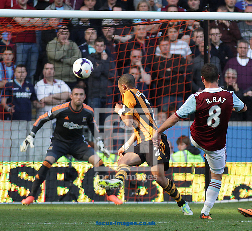 Picture by Richard Gould/Focus Images Ltd +44 7855 403186<br /> 28/09/2013<br /> Răzvan Raţ of West Ham United shoots for goal during the Barclays Premier League match at the KC Stadium, Kingston upon Hull.