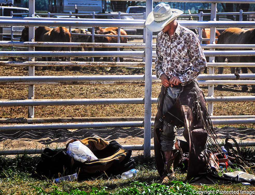 Rodeo Cowboy prepares for their event under sweltering temps in Burwell, Nebraska. Photo by accomplished Lincoln Nebraska Sports Photographer Barry A Mosley.