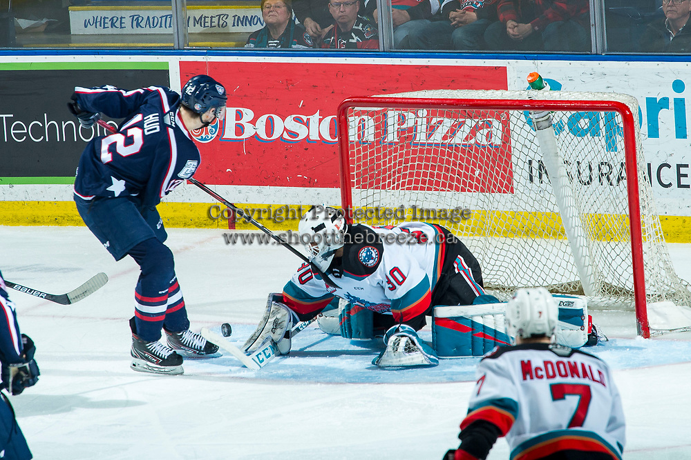 KELOWNA, BC - FEBRUARY 12: Roman Basran #30 of the Kelowna Rockets makes a third period save on a shot by Samuel Huo #12 of the Tri-City Americans at Prospera Place on February 8, 2020 in Kelowna, Canada. (Photo by Marissa Baecker/Shoot the Breeze)