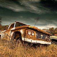 An abandoned rusty pickup found in a scrap yard in Arkansas