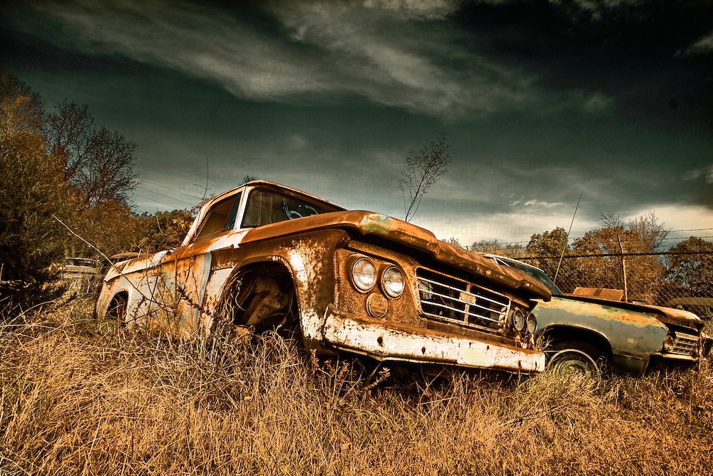 An abandoned rusty pickup found in a scrap yard in Arkansas