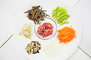 Ingredients for bibimbap,  the popular Korean dish that is served with warm rice mixed with a wide variety of ingredients, usually beef and vegetables. Seoul, South Korea