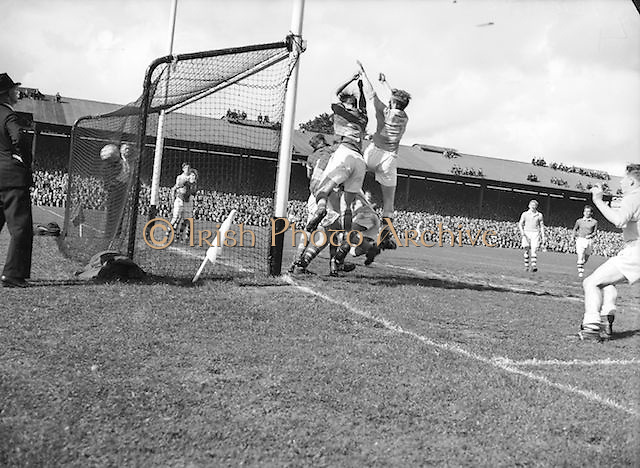 Players attempt to save the ball during the All Ireland minor Gaelic Football Final Dublin v Tipperary in Croke Park on 25th September 1955.