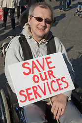Demonstration against Coalition cuts to disabled people's services and income. Wheelchair user