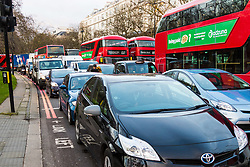 PICTURED: Rush hour traffic comes to a standstill at Marble Arch as anti-pollution demonstrators block the road at Marble Arch. Demonstrators from the anti-pollution group Stop Killing Londoners cause traffic chaos for London commuters as they conduct a series of short roadblocks at Marble Arch stopping cars and buses from entering Oxford Street and Park Lane. Irate motorists accused them of creating more pollution than they were stopping, whilst the group said their objectives were long term. A leaflet handed out to motorists says the government is not doing enough to tackle the crisis costing 'taxpayers and the NHS £billions [sic] a year'. PLACE, January 29 2018. © Paul Davey
