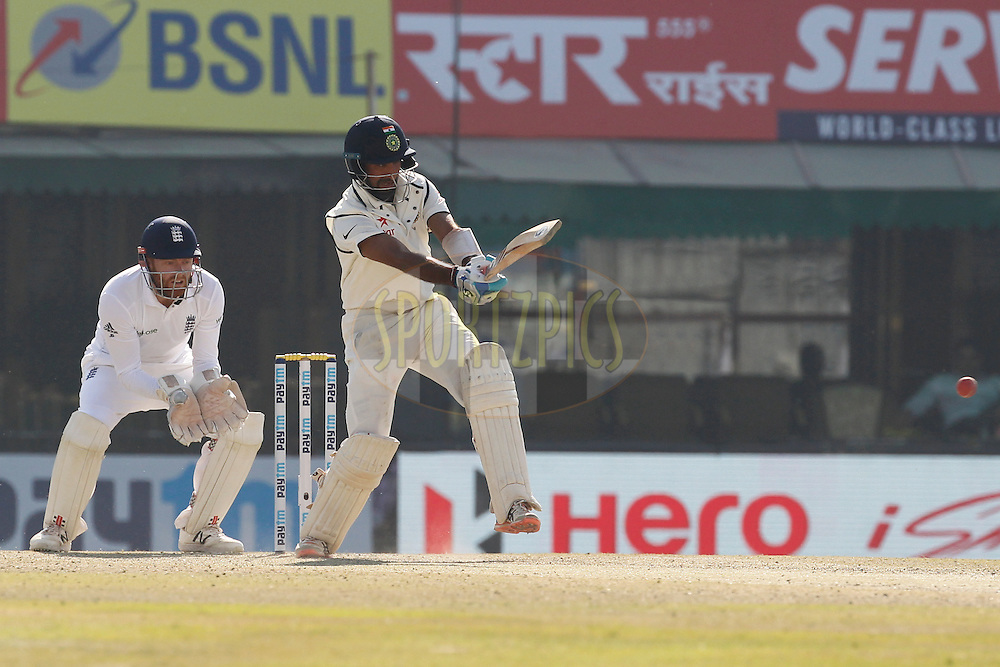 Cheteshwar Pujara of India bats during day 2 of the third test match between India and England held at the Punjab Cricket Association IS Bindra Stadium, Mohali on the 27th November 2016.<br /> <br /> Photo by: Deepak Malik/ BCCI/ SPORTZPICS
