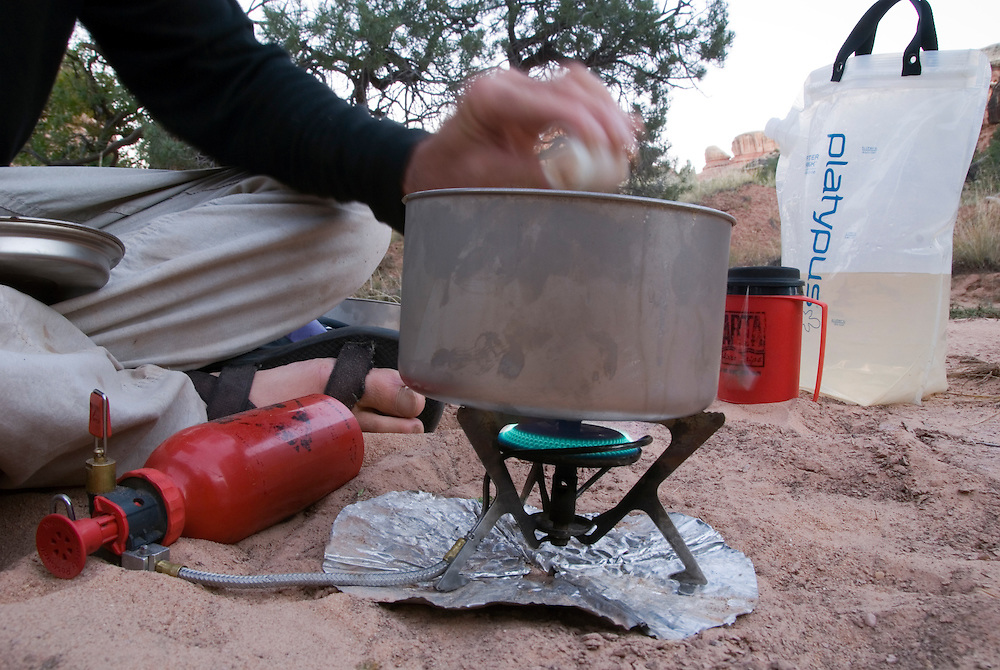 Cooking a meal on a backpack trip in Canyonlands National Park, Utah.