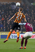 Hull City defender Michael Dawson (21) heads the ball clear  during the EFL Sky Bet Championship match between Hull City and Aston Villa at the KCOM Stadium, Kingston upon Hull, England on 31 March 2018. Picture by Mick Atkins.